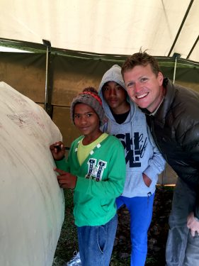Mark Rutherfoord with children from Herbertsdale Primary